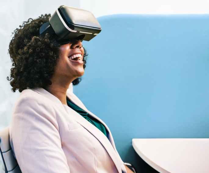 woman wearing white robe and black virtual reality headset