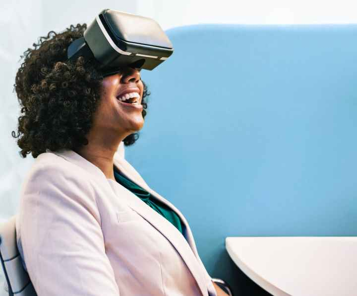 woman wearing white robe and black virtual reality headset